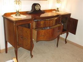 French country buffet with highly figurative maple and mahogany inlays