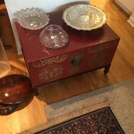 Asian lacquered chest on stand, with assorted crystal & glass table ware.