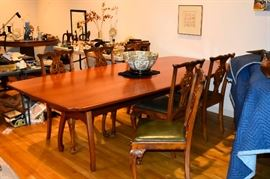 Custom made dining table with 6 centennial Chippendale style English chairs circa 1880.