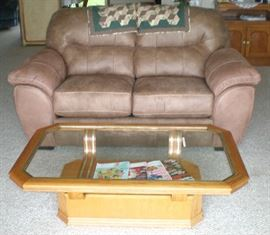 Beautiful overstuffed loveseat, only one year old, like new condition, and glass top coffee table.