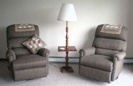 Two neutral brownish tone swivel rocking recliners, excellent condtion. Floor lamp with table.