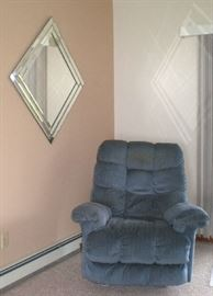 Oversize blue recliner, very good condition, large wall mirror.