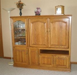 Oak entertainment center with large TV cabinet.