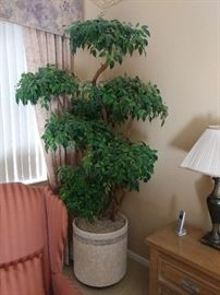 Large faux tree in the master bedroom