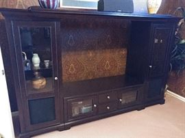 Large entertainment center in the den