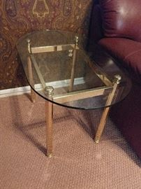 Glass and brass table in the den