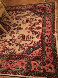 Assorted vintage rugs.