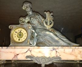 Antique figural metal clock on marble base.