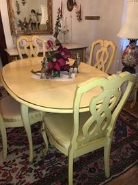 Vintage white drop leaf table and 6 chairs.