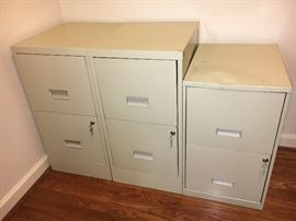 3 metal file cabinets with keys.