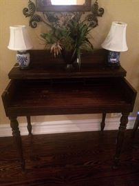 Small antique desk (top folds out); two small blue & white lamps; floral arrangement