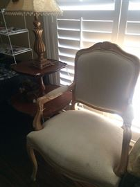 French provincial chair, tiered table, and lamp