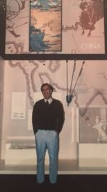Artist, Albert Lane standing with his work while hanging at the National Air & Space Museum.