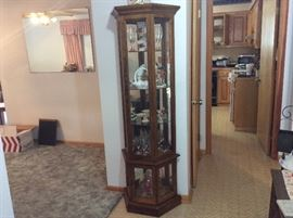 Curio cabinet full of collectibles