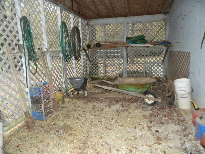Barn area - wheels barrow, buckets, seeder, hoses, crates, and more