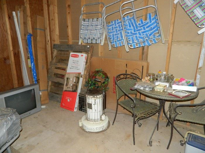 lawn chairs, heater, pallet, tv, lawn chairs, table & chair set.