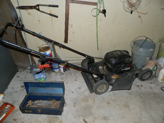 Murray push mover, tool box, other items on wall.
