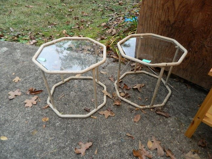 Two matching glass top tables