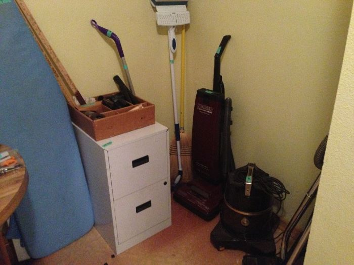 File cabinet, ironing board, rainbow vacuum