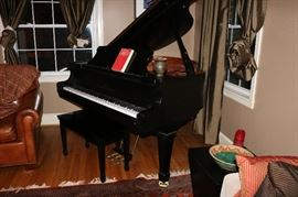 1999 Young Chang Ebony Baby Grand Piano in excellent condition.