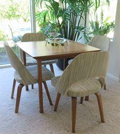Knoll game table. Saarinen set/4 executive side chairs.