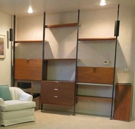 Herman Miller/George Nelson upright wall unit with three bays and eight (8) shelves and cylindrical lighting.
