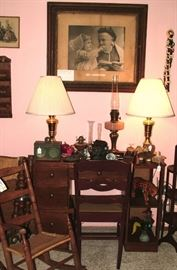 Antique Desk and Chair, Antique childs rocking chair, brass lamps, oil lamps, antique frames prints and original artwork, antique horse reins and bits, figurines, signed paperweights and so much more!