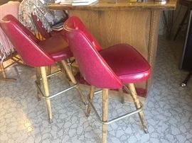 Retro red barstools and free standing bar