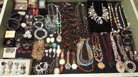 Jewelry including real gemstones, gold, silver, Scaasi necklaces, Graziano necklaces, Victoria Wieck watch, Heidi Daus ring, Badgley Mischka ring, Monies cow bone earrings, Barse sterling turquoise ring, and more