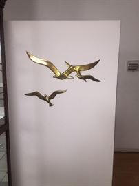 Stylish hanging brass sculpture....Beautiful and super Mod. We have many
