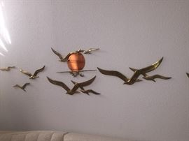 Stylish hanging brass sculpture....Beautiful and super Mod