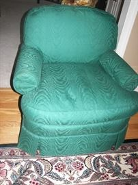 green club chair and detail of rug