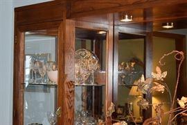 dimming lights, gleaming bronzed glass, glass shelves