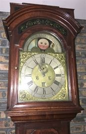 Closeup of face of vintage grandfather clock