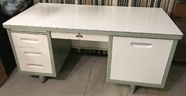 Mid-century modern tanker desk. Right door opens to reveal a pop-up typewriter shelf.