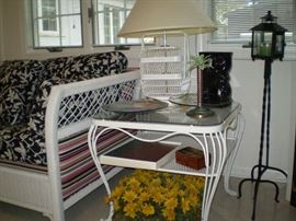 pair of metal side tables and wicker lamps