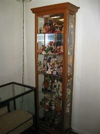 curio cabinet full of dolls