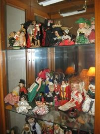 many small dolls from around the world