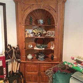 This a wonderful honey-colored corner cabinet.