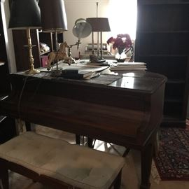 This is a Fisher grand piano -- a dramatic accent with bench.