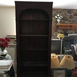 A nice book case unit -- notice matching lamps, early World's Fair framed document, standing lamp -- the place is packed!