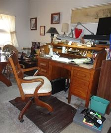 C Curve roll top desk and antique office chair.