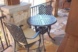 Small metal table and two chairs