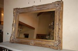 Large ornate mirror with gold frame