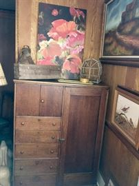 Antique oak wardrobe is a great functional piece for an office, craft room or kitchen/dining room. Note the pieces of art -- including a moody oil landscape and a piece featuring a pair of quail.