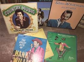 Remarkable collection of country music albums. More than what you see here. Check out that Waylon Jennings LP peeking out from the back.