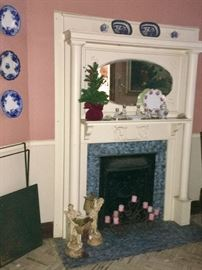 This mantle is set off with Victorian-era blue willow ironston.Austrian porcelain, crystal S&P shakers, a candelabra and two peasant girl ceramic pieces.