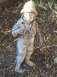 Several pieces of weathered concrete statuary