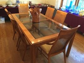 """Glass and OakDining Room Table with 2 Leaves, Table Pads and 10 Wide Cane Back Chairs fromArtifacts by Henredon (69"""" x 42"""" x 30"""")"""