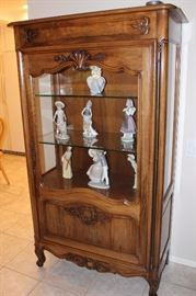 Antique curio cabinet, glass shelves and light in top with key for locking.
